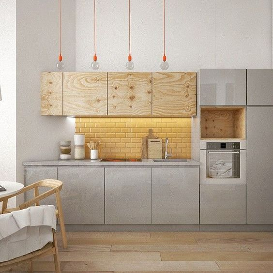 kitchen, wooden floor, grey bottom cabinet, brown wooden uper cabinet, shelves, yellow subway bakcsplash, bulb pendants with orange line