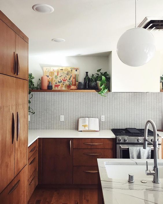 kitchen, wooden floor, small tiles backsplash, white wall, built in shelves, white round pendant, wooden pantry, wooden island, white kitchen top
