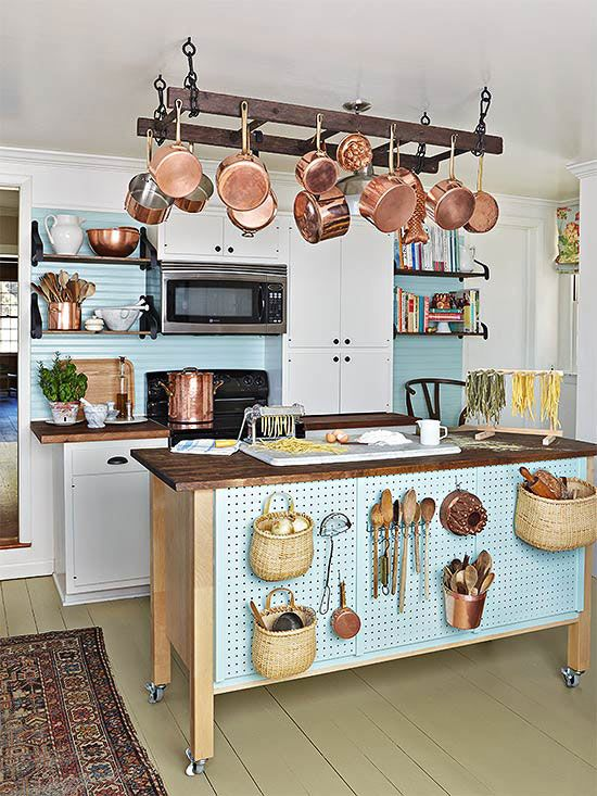 kitchen, wooden floor, white cabinet, blue backsplash, blue wall, blue pegboard on the wooden island, hanging racks
