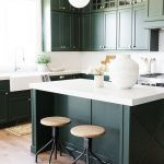 Kitchen, Wooden Floor, White Wall And Backsplash, White Top Island, Dark Green Cabinet And Island, Wooden Stools