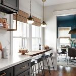 Kitchen, Wooden Floor, White Wall, Black Bottom Upper Cabinet, White Kitchen Top, White Marble Backsplash, Pendant, Rattan Shade