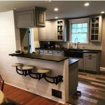 Kitchen, Wooden Floor, White Wooden Wall And Bar With Black Top, White Cabinet, Subway Backsplash Tiles, Black Kitchen Top