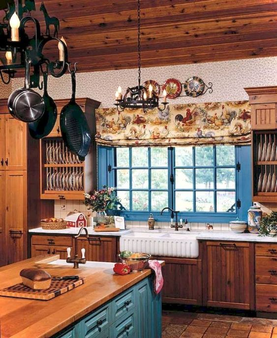 kitchen, wooden floor, wooden bottom cabinet, blue wooden island with wooden top, wooden island, chandelier,
