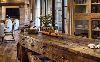 kitchen, wooden floor, wooden glass cabinet, wooden island with shelves below, chandelier