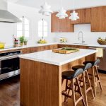 Kitchen, Wooden Floor, Wooden Island With White Top, Wooden Cabinet, White Kitchen Top, White Wall, White Pendants, Wooden Upper Cabiet, Hood