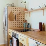 Kitchen, Wooden Floor, Wooden Kitchen Top With Shelves Under, Wooden Pegboards On The Side Of The Fridge, Floating Shelves,