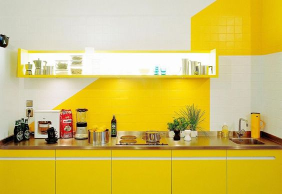 kitchen, yellow bottom cabinet, white yellow tiles wall, yellow floating shelves with LED lights, wooden kitchen top
