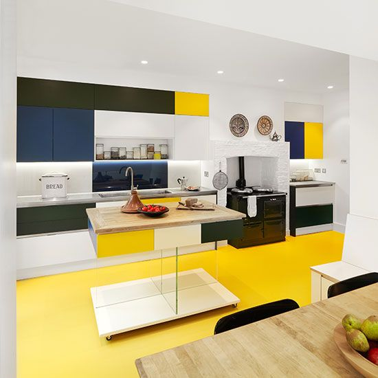 kitchen, yellow seamless floor, white wall, white ceiling, built in shelves, white blue green yellow upper cabinet, wooden dining set