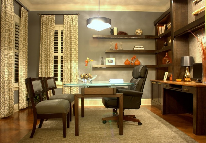 leather executive office chair pendant lamp glass and wooden desk gray chairs area rug wooden shelves table lamp windows patterned curtains wall mounted shelves