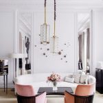 Long Geometric Glass Pendant, White Wall, Brown Rug, Pink Chairs, Black Coffee Table, White Curvy Sofa, White Floor Lamp