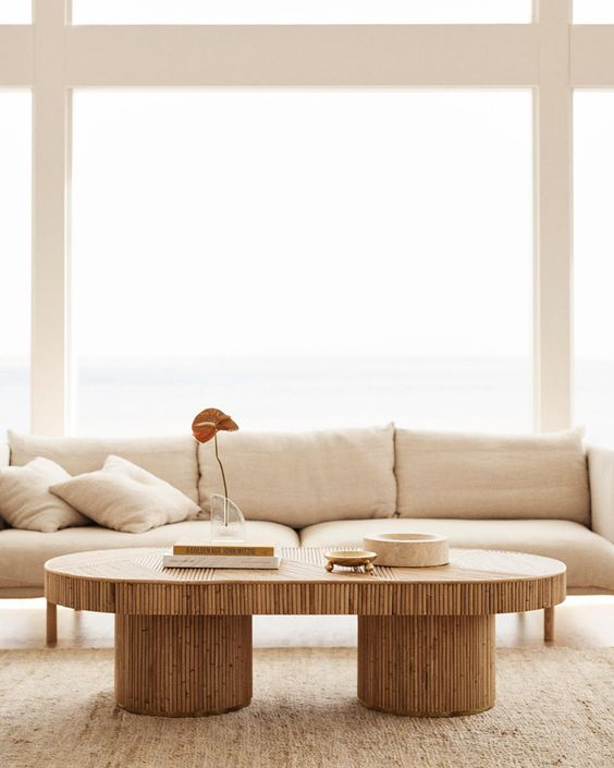 modern living room, brown rug, wooden coffee table, beige sofa, large glass window