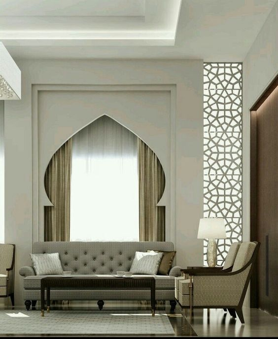moroccan arch on the window, beige wall, carving, seamless floor, sofam chairs, table lamp, ottoman for coffee table