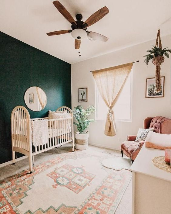 nursery, beige floor, dark green wall, white wall, ceiling fan, wooden cabinet, pink chair, brown curtain, hanging plant, moroccan rug