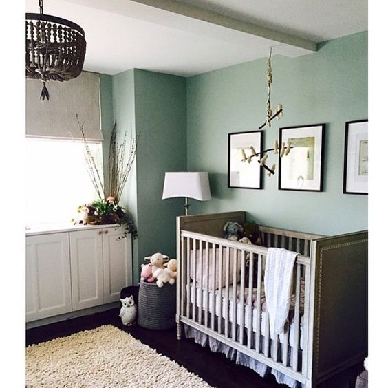 nursery, dark wooden floor, crib, green wall, rattan pendant, ceiling decoration, white cabinet, shade