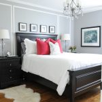 Over Bed Lighting White Shades Glass Table Lamps Pillows Black Bed Headboard Black Nightstands Shag Rug Wooden Floor White Trims Artwork Gray Walls