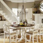 Pedestal Dining Table With Leaf Industrial Chandelier Rattan Rug White Stairs White Console White Dining Chairs Wall Mirror Fireplace