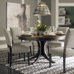 Pedestal Dining Table With Leaf Pendant Lamp Gray Herringbone Rug Black Flooring Gray Chairs Gray Walls Artwork White Wall Trim