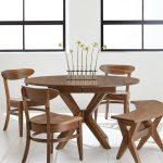 Pedestal Dining Table With Leaf Wooden Dining Table Wooden Dining Chairs White Walls White Floor Tile Black Framed Glass Windows Small Flower Bottles