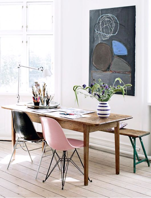 pink black mid century modern chairs, wooden rectangular table, long wooden bench, white wall, wooden floor