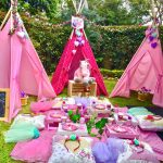 Pink Fabric Tents With Pink Rug, Pilows, Tables