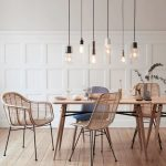Rattan Chairs, Grey Chair, Wooden Dining Table, Clear Bulbs Pendants, Wooden Floor, White Wainscoting