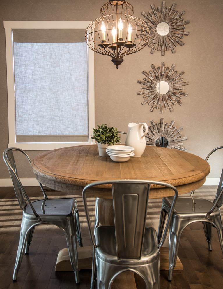 rustic dining table pedestal dining table antique chandelier wall mirror window silver chairs wooden floor gray wall
