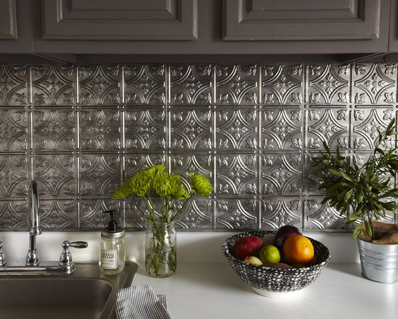 silver tin backsplash, white counter top, silver sink, grey upper cabinet