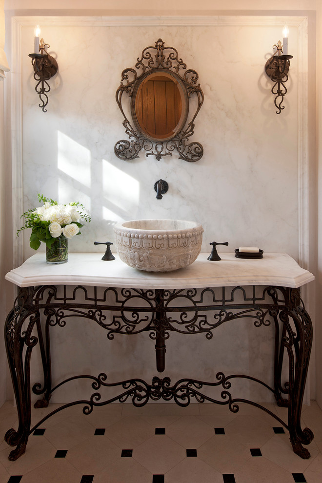 sink bowl antique wall mirror antique wall sconces black and white floor tile antique vanity wall mounted faucet flower vase soap