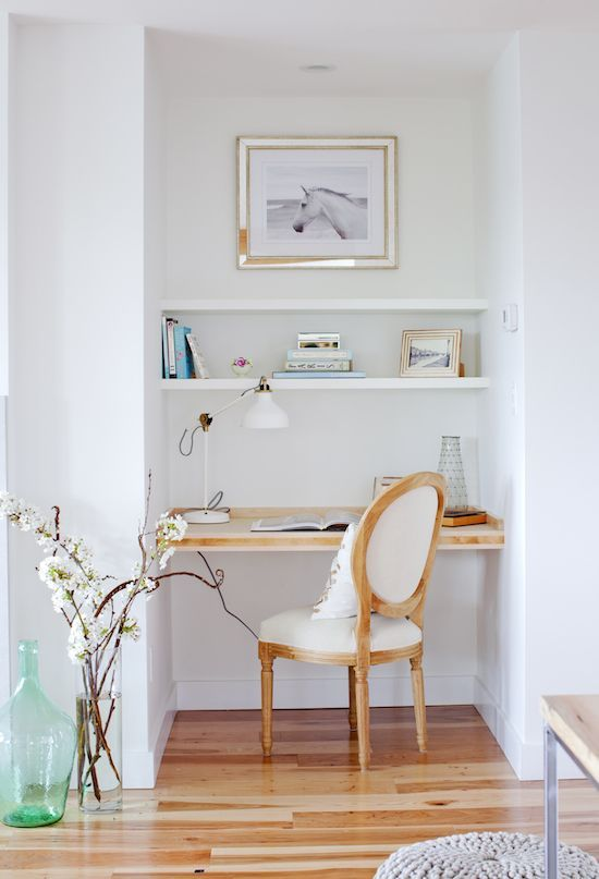 small alcove, wooden floor, white wall, white floating shelves, floating table, white chair