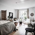 Small Apartment, Wooden Floor, White Wall, Grey Bedding, Short Parition, White Sofa, Small Round Coffee Table, White Lounge Chair, White Side Table, Round Mirror