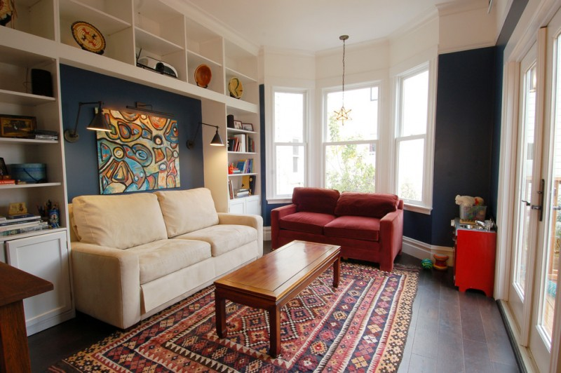 small living room ideas pinterest patterned area rug wooden coffee table red and beige sofas built in shelves windows black wall sconces glass doors