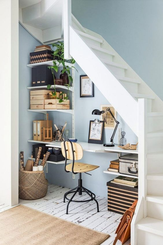 space under the stairs, floating shelves, floating study table, wooden office chair, white wooden floor, white wooden stairs