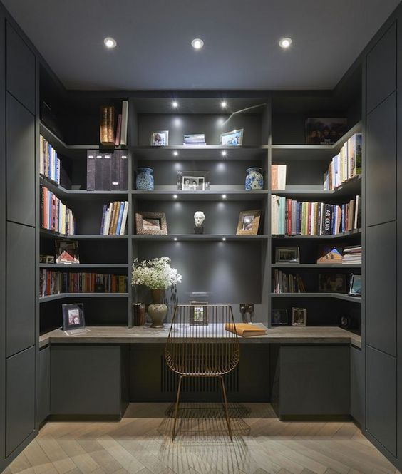 study in alcove, black painted wall and cabinet, built in shelves, marble table