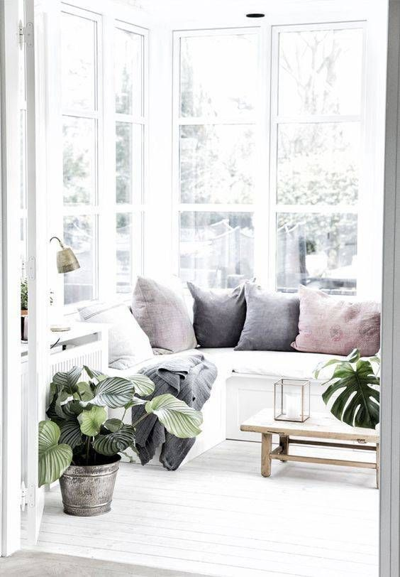 sun room, white wooden floor, white wooden bench, pillows, glass window, wooden coffee table