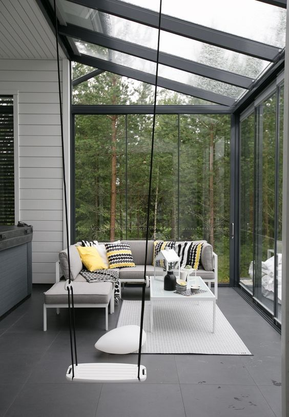 sun rooms, grey floor, glass wall and ceiling, grey sofa