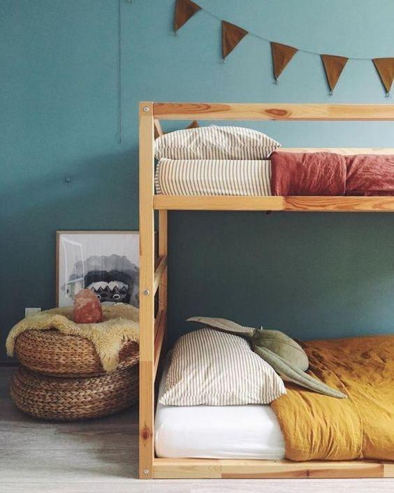 think light wooden bunbed, wooden floor, rattan ottoman, green wall