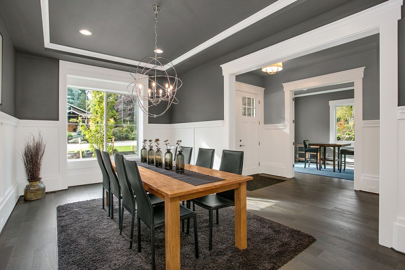 transitional dining room sets chandelier dark shag rug wooden dining table black dining chairs white and gray walls glasss windows
