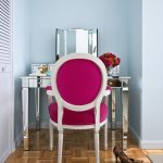 Vanity Chair Pink Chair Chrome Vanity Desk Wooden Floor Blue Walls Glass Flower Vase Chrome Drawers Small Vanity Mirror Blue Walls
