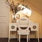 Vintage Bedroom Vanity Round Wall Mirror Glass Flower Vase White Vanity White Chair With Hole Back Yellow Wall Drawers White Door