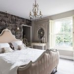 Vintage Bedroom Vanity Wallpaper Window Chandelier Bed Headboard Wall Sconces White Chairs White Bedding Pillows