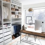 Walking Closet In The Study Room, Wooden Floor, White Rug, White Wooden Open Cupboard, Rails To Hang Clothes, Shelves, Drawers