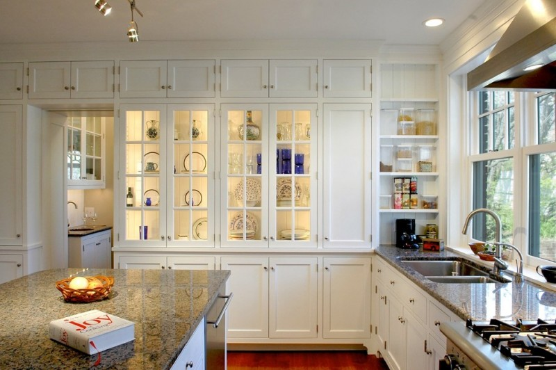 white cabinet with glass door cabinet lighting granite countertop glass windows range hood stove double sink white shelves