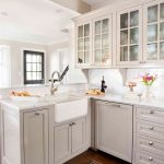 White Cabinet With Glass Door Dishwasher Farmhouse Sink Mediterranean Kitchen Rug Windows White Backsplash White Countertop Faucet