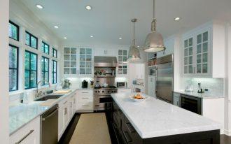white cabinet with glass door industrial pendant lamps black island white countertops windows sink dishwasher stove rangehood kitchen mat
