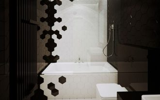 white hexagonal tiles on middle floor, tub, and wall, black hexagonal tiles on wall left right, white toilet, white tub, black table cabinet white drawers, white sink