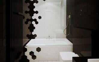 white hexagonal tiles on middle floor, tub, and wall, black hexagonal tiles on wall left right, white toilet, white tub, black table cabinet white drawers, white sink