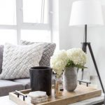 White Marble Coffee Table, Wooden Tray, Grey Sofa, Pillows, White Floor Lamp