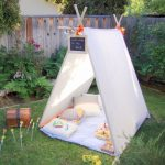 White Simple Triangular Tent With White Rug, Pillows