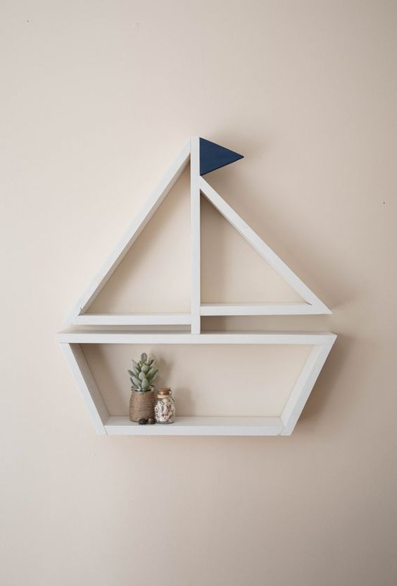 white wooden floating shelves shaped like a sailboat
