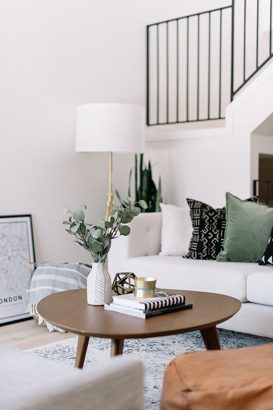 wooden coffee table, grey rug, white sofa, white floor lamp